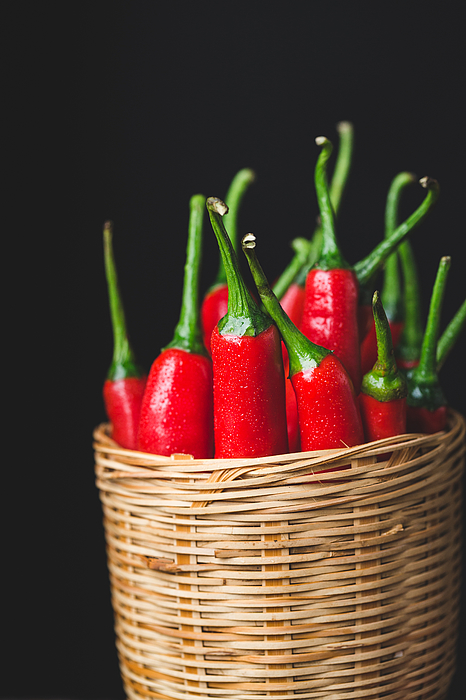 Close-Up Of Red Chili Peppers In Wicker Basket Against Black Background Photograph by Thu Thai Thanh / EyeEm