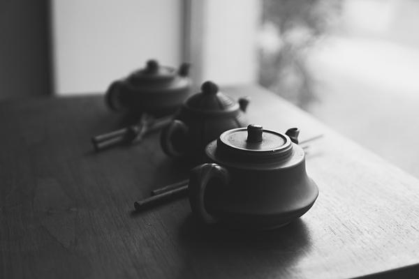 Close-Up Of Teapots On Table Photograph by Nuchanat Wongpranee / EyeEm
