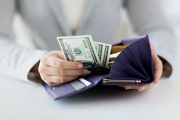 Close Up Of Woman Hands With Wallet And Money Photograph by Dolgachov