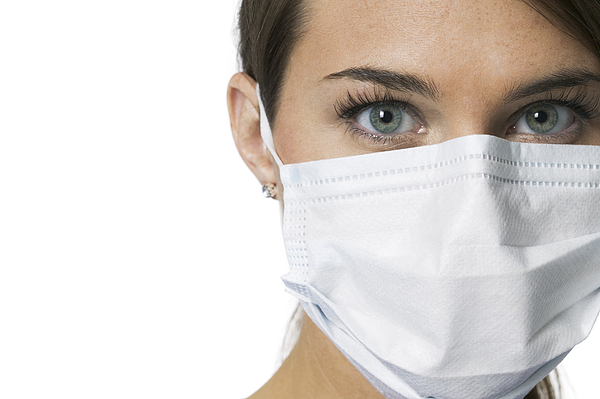 Close Up Portrait Of A Young Adult Female Nurse In A Mask As She Looks At The Camera Photograph by Photodisc