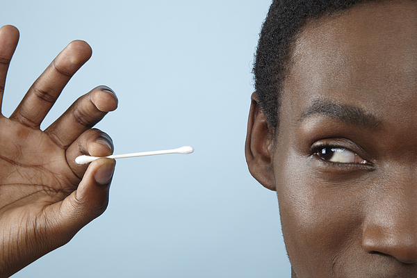 Close Up Young Man Holding Cotton Bud Photograph by Emma Innocenti