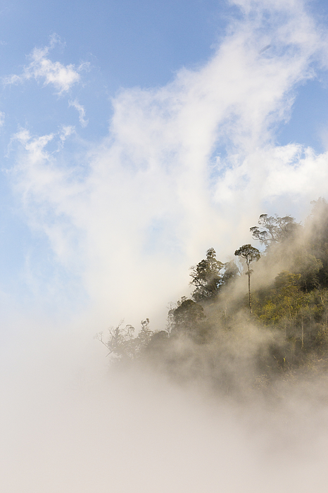 Clouds rising over mountain top Photograph by Merten Snijders