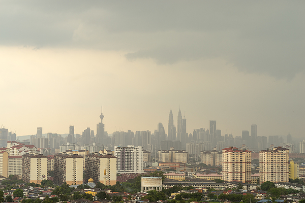 Cloudy Moments Of Downtown Kuala Lumpur With Petronas Twin Towers And Kl Tower Dominant The Skyline. Photograph by Shaifulzamri