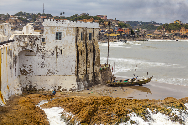 Coast edging wing of Cape Coast Castle Photograph by Merten Snijders