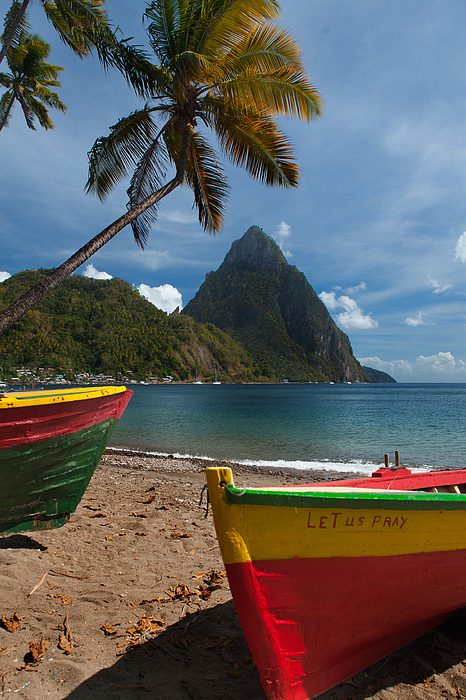 Colorful boats on the beach in  Soufrieire, St Lucia with the Pitons in the background.The famous Pitons of St Lucia are volcanic plugs rising out of the sea at the south end of the island. Photograph by Reed Kaestner