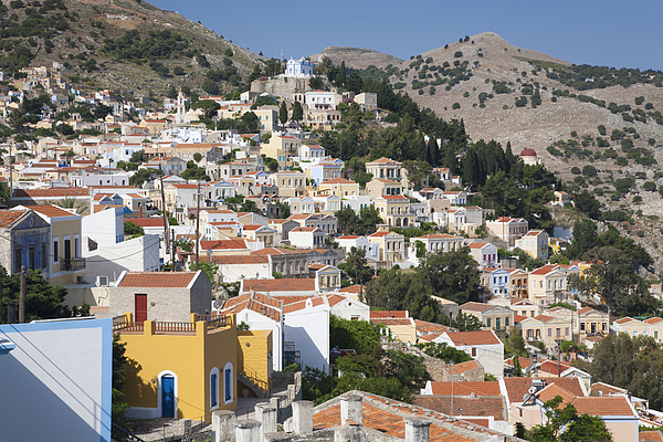 Colourful houses on hillside, Horio, Symi, Greece Photograph by David C Tomlinson