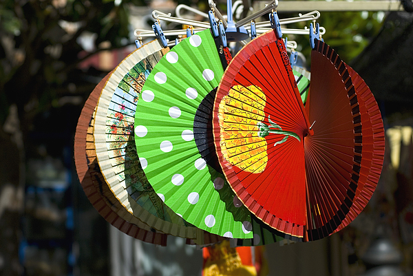 Colourful Spanish fans for sale in marketplace Photograph by Lyn Holly Coorg