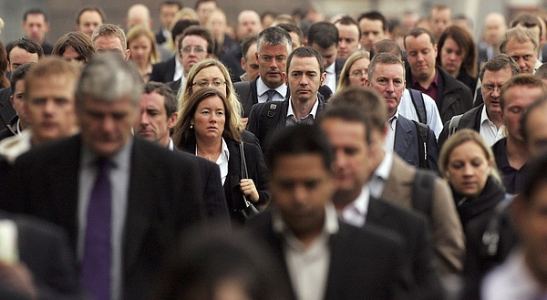 Commuters Flock To Work In The City Of London Photograph by Scott Barbour