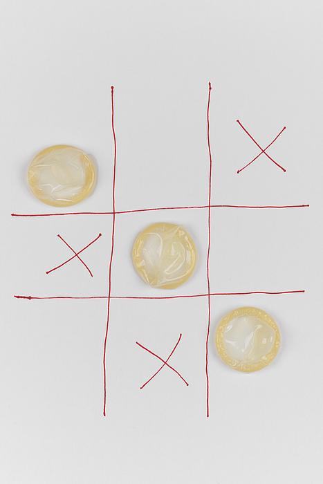 Conceptual importance of using condoms Photograph by Lucapierro