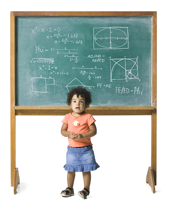 Conceptual Shot Of A Young Female Child In Front Of A Problem On A Chalkboard Photograph by Photodisc