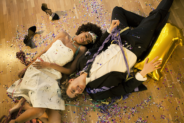 Couple lying down on the floor Photograph by Orbon Alija
