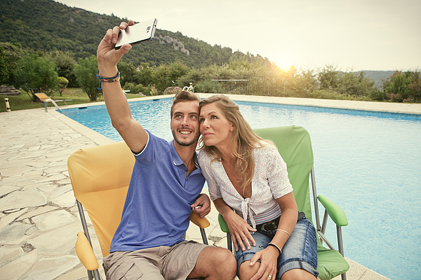 Couple on Holiday taking a selfie in france Photograph by Marcus Clackson