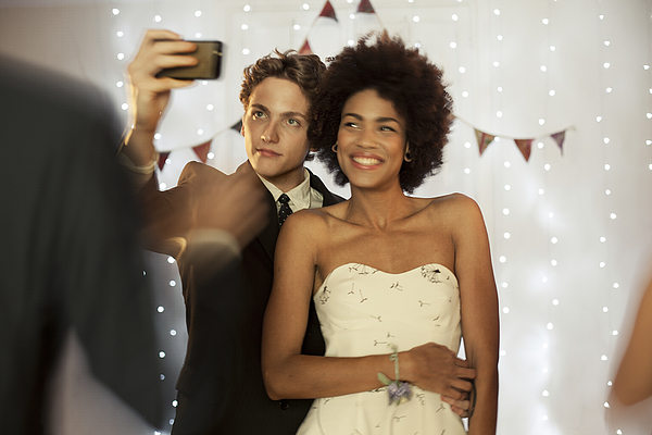Couple taking a selfie at prom party Photograph by Orbon Alija