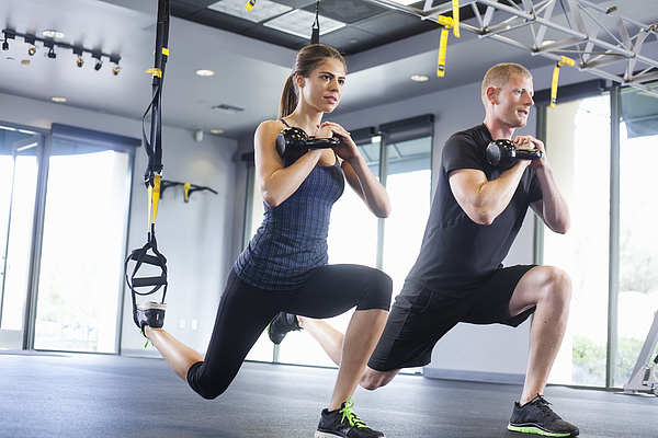 Couple working out with weights Photograph by Kevin Kozicki