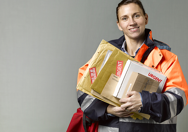 Courier/postwoman with copy space Photograph by Peter Dazeley