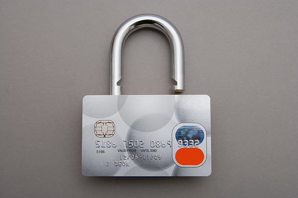 Credit card lock Photograph by Image Source