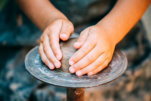 Cropped Hands Of Potter Making Clay Pot At Pottery Photograph by Ryhor Bruyeu / EyeEm