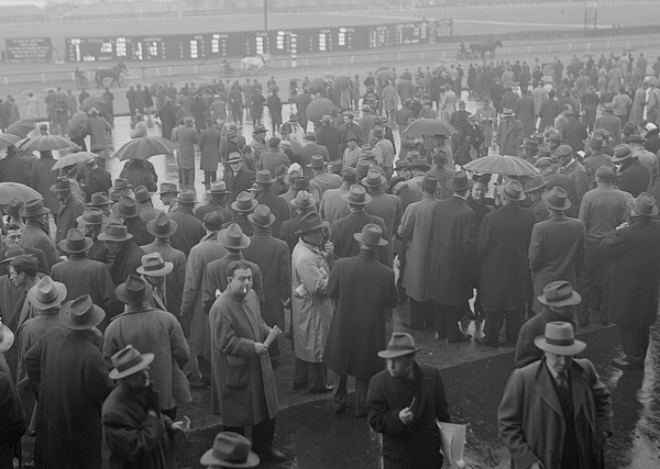 Crowds at horse race Photograph by George Marks