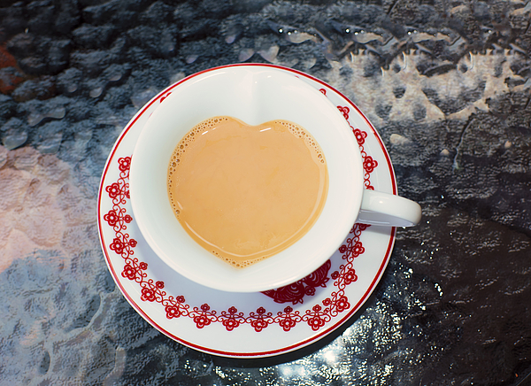 Cup of tea in heart shape cup Photograph by Lyn Holly Coorg