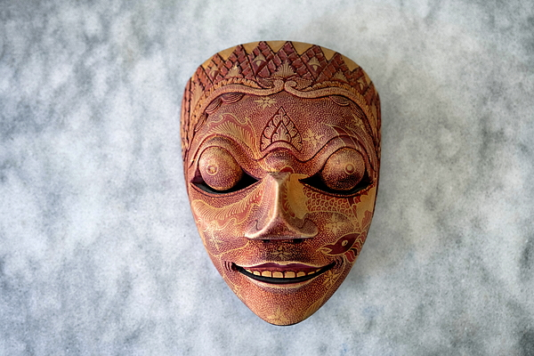 Decorative Wooden Mask From Far East On Gray Marble Tabletop Photograph by Emreturanphoto