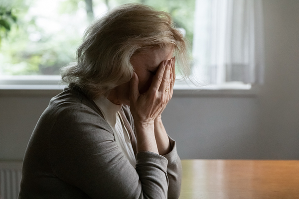 Depressed mature OAP 60s woman going through crisis Photograph by Fizkes