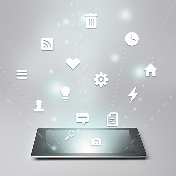 Digital tablet and Variety of icons Photograph by Yagi Studio