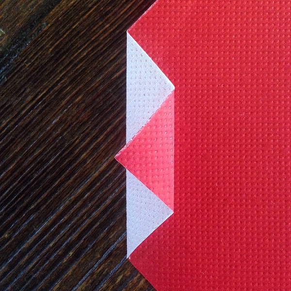Directly Above Shot Of Folded Red Paper On Table Photograph by Francesco Marino / EyeEm