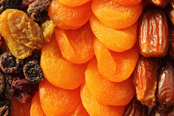 Dried fruit assortment of dates, raisins and apricots Photograph by Pejft