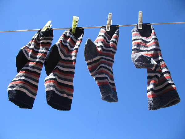 Drying Socks Photograph by Stwief