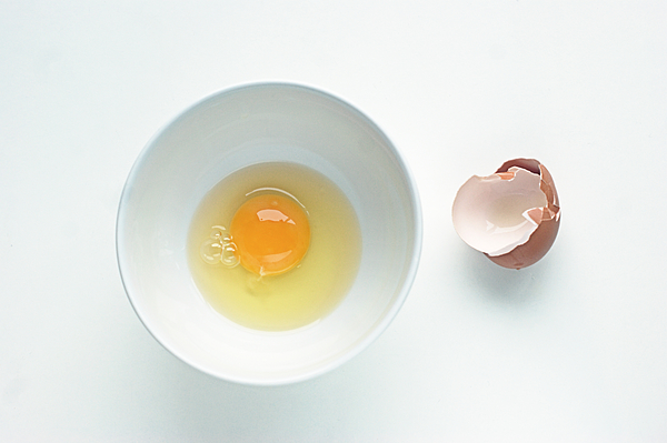 Egg in a white round bowl Photograph by Gregoria Gregoriou Crowe fine art and creative photography.