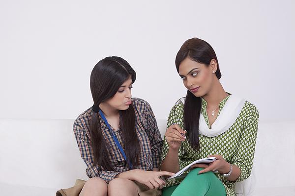 Elder sister teaching younger sister Photograph by Sudipta Halder