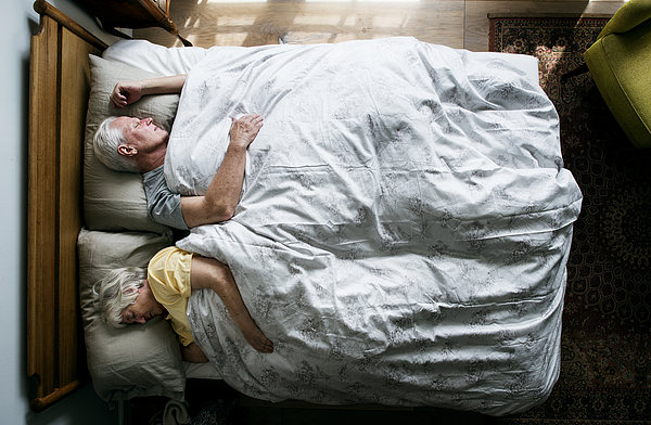 Elderly Caucasian couple sleeping on the bed Photograph by Rawpixel