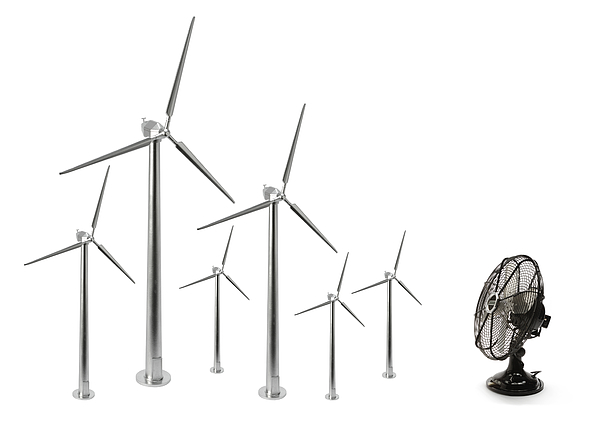 Electric fan and six wind turbines Photograph by Nicholas Eveleigh