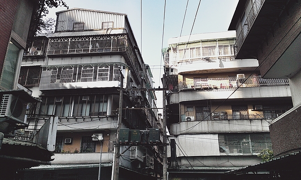 Electricity Pylon Amidst Residential Buildings Photograph by Rob Yale / EyeEm