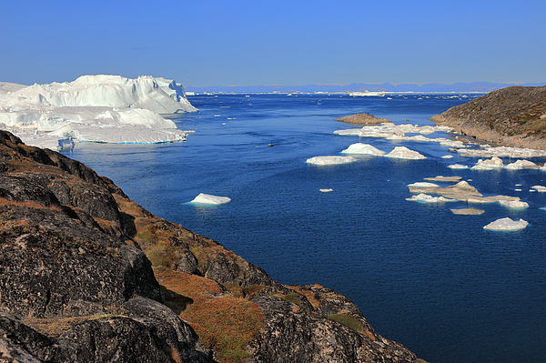 Elevated View From Rocky Terrain At Huge Icebergs Photograph by Rainer Grosskopf