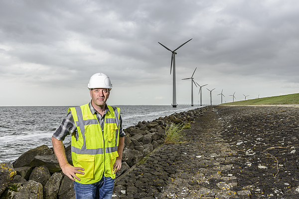 Engineer At An Offshore Wind Turbine Park During An Overcast Day Photograph by Sjo