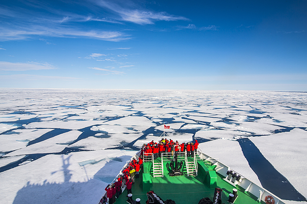 Expedition boat navigating through the pack ice in the Arctic shelf, Svalbard, Arctic Photograph by Michael Runkel