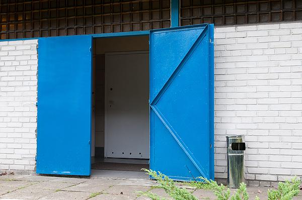 Exterior Of Brick Building With Blue Doors Photograph by Piotr Hnatiuk / EyeEm