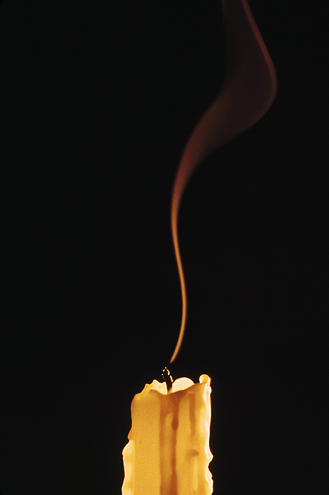 Extinguished candle Photograph by Comstock