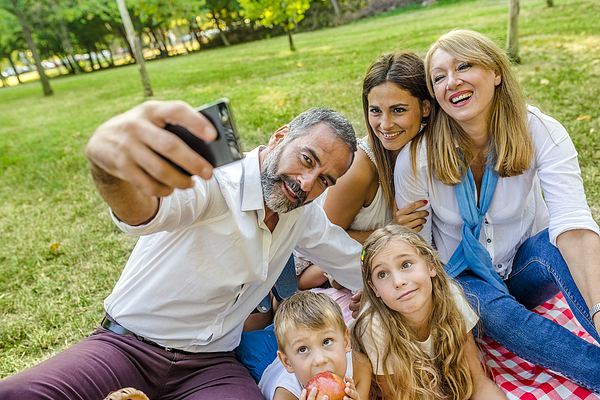 Family time wouldnt be complete without a selfie Photograph by Ljubaphoto
