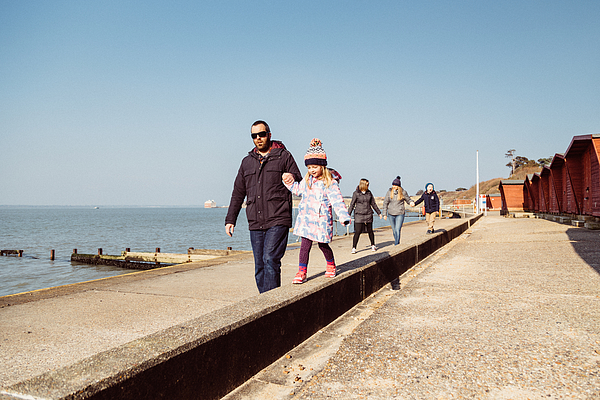 Family walk along the coast Photograph by s0ulsurfing - Jason Swain