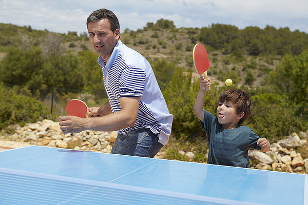 Father and son playing table tennis Photograph by Frank and Helena