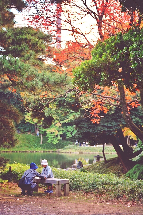 Father Talking With His Son In Park Photograph by Keiko Tanaka / EyeEm