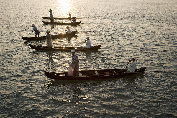 Fishermen at dawn in Cochin, India Photograph by John Lund