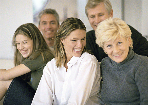 Five people grouped together, smiling, close-up, portrait. Photograph by Eric Audras