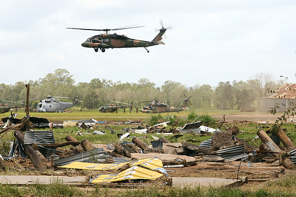 Flood Damaged Queensland Towns Continue Missing People Search Photograph by Jonathan Wood