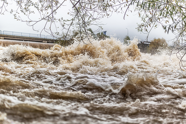 Flooded river during persistent heavy rain. Photograph by SimpleImages