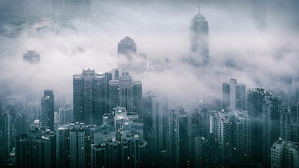 Fog over Hong Kong Photograph by Andi Andreas