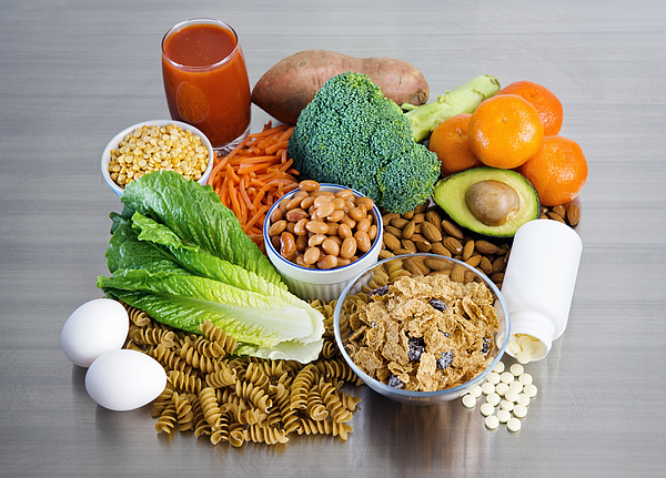 Folic Acid Supplement And Foods On Stainless Kitchen Counter Photograph by Fertnig
