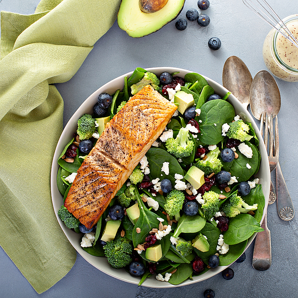 Fresh spinach and feta salad with salmon Photograph by VeselovaElena